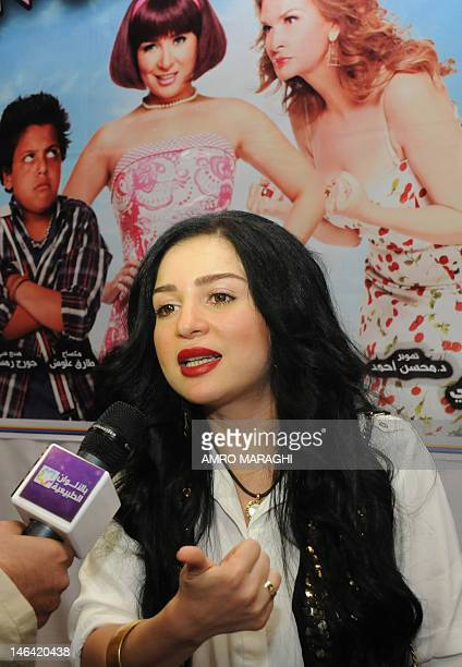Egyptian actress May Ezzeddine speaks to a TV journalist at the premiere of her new film 'Game Over' at a movie theatre in Cairo late on June 15 2012...