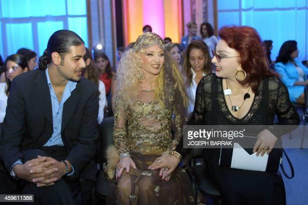 Egyptian actress Nabila Obeid chats 15 September 2002 with Lebanese singer Sabah and Model Omar Mehio during Lebanese designer Zuhair Murad's fashoin...