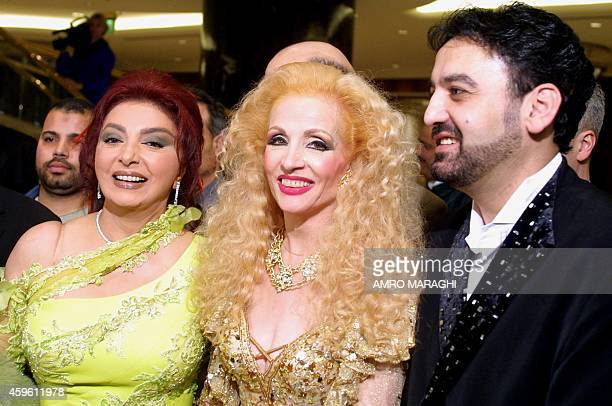 Egyptian actress Nabila Obeid poses with Lebanese singer Sabah and her husband Fadi during her birthday party 09 February 2002 at a fivestar hotel in...