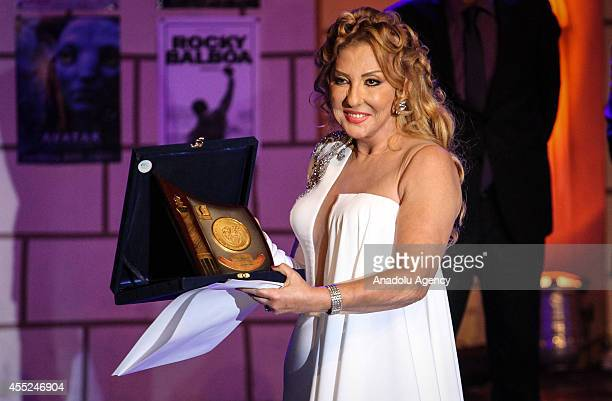 Egyptian actress Nadia AlJundi poses with her award during the 30th Alexandria Film Festival in Alexandria Egypt on September 10 2014 The film...