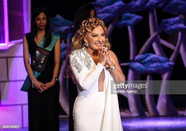 Egyptian actress Nadia AlJundi salutes the audience after she receives her award during the 30th Alexandria Film Festival in Alexandria Egypt on...