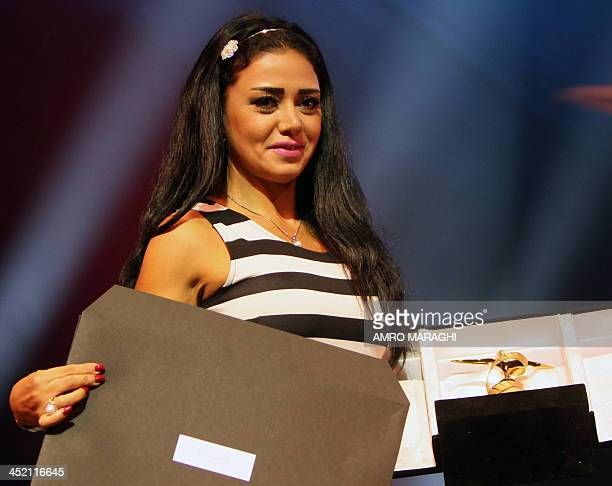 Egyptian actress Rania Youssef receives the best actress award for her role in the film 'One who's True' during the closing ceremony of the 17th...