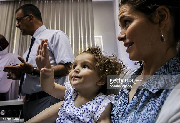 Egyptian actress Yosra El Lozy and her 20month hearing impaired child Dalila are seen after coming around with brain stem surgery and cochlear...