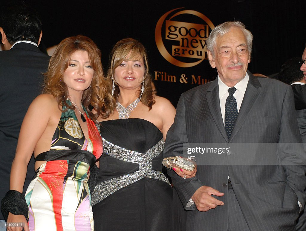 Egyptian actresses Ola Ghanem (L) and Leila Elwi (C) and veteran actor Jamil Rateb (R) pose together during a party after a special screening of the award-winning film 'Baby Doll Night' (Lailat al-Babi Doll) in Cairo late on May 28, 2008. Big names and stars from Egyptian cinema attended the premier of Baby Doll Nights directed by Adel Adib and starring Nur al-Sherif and Leila Alwi, which portrays problems, sex and politics in the Arab world and was screened on the sidelines of the Cannes film festival in France. In the film Sherif plays an Egyptian war reporter who is arrested and tortured in Iraq's infamous Abu Ghraib prison, from where he eventually escapes to join the resistance to US forces in Iraq.
