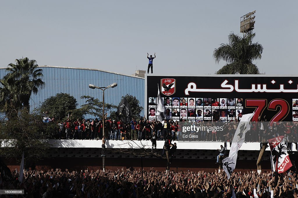 Egyptian 'Ahly Ultra' soccer fans gather at the Al Ahly home stadium during celebrations after the announcement that 21 fans of the Al Masry football club involved in a football stadium massacre last year were sentence to death on January 26, 2013 in Cairo, Egypt. A verdict was announced Saturday in a case over the deaths of more than seventy fans of Egypt's Al-Ahly football club in a stadium massacre on February 1, 2012, in the northern city of Port Said, during a riot that began minutes after the final whistle of a match between Al-Ahly and Al-Masry. 21 fans of the Al Masry football club were given the death penalty in the court case, a verdict that must now be approved by Egypt's Grand Mufti. The verdict was handed down during a period of high tension across Egypt, one day after the second anniversary of the beginning of Egypt's 2011 revolution that overthrew the regime of former President, Hosni Mubarak.