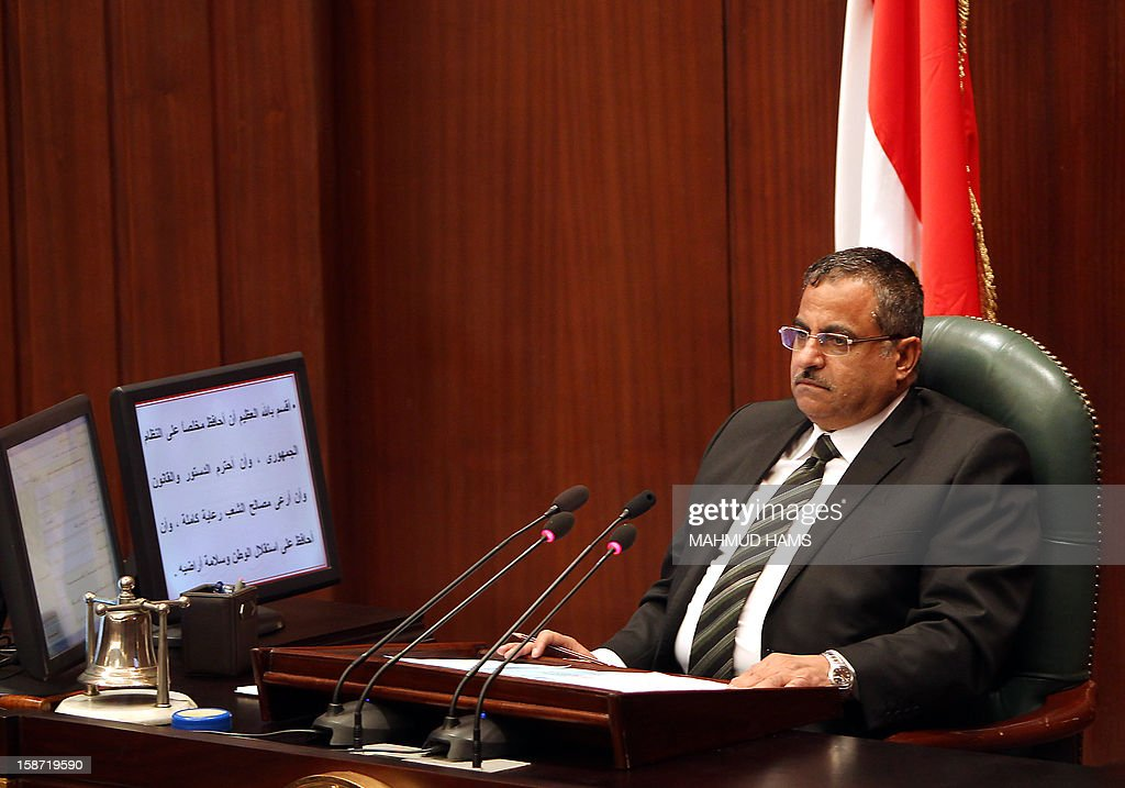 Egyptian Ahmed Fahmi, head of the Shura Council, the upper house of parliament where the Constituent Assembly drafted the country's new constitution, chairs a council meeting on December 26, 2012 in Cairo. Egyptian President Mohamed Morsi has signed into law a new constitution voted in despite weeks of opposition protests, but he was left facing an economic crisis and international disquiet over his rule.