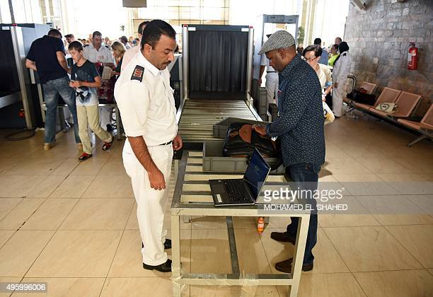 Egyptian airport security check passenger's luggage as they pass through security in Egypt's Red Sea resort of Sharm ElSheikh on November 6 2015...