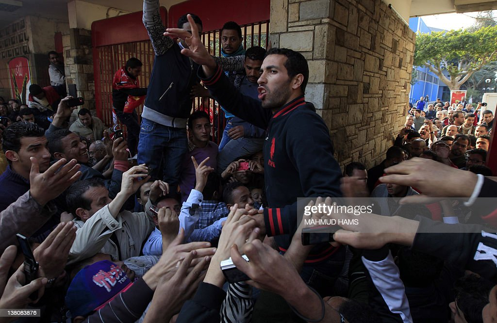 Egyptian AlAhly football player Mohammed Abu Trika shots slogans as fans gather outside AlAhly club in Cairo on February 2 2012 before marching to...