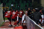 Egyptian AlAhly players escape from the field as fans of AlMasry team rush to the pit during clashes that erupted after a football match between the...