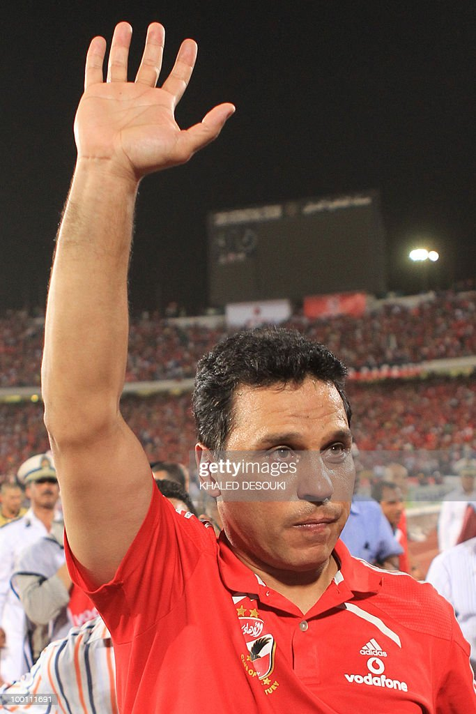 Egyptian Al-Ahly's head coach Hossam El-Badry acknowledges the audience after his team's victory over Libyan Al-Ittihad in African Champions League third round second leg football match in Cairo on May 9, 2010. Al-Ahly won 3-0.