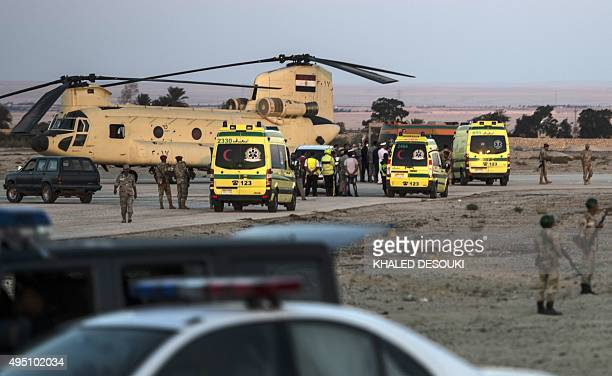 Egyptian ambulances carrying the corpses of Russian victims of a Russian passenger plane crash in the Sinai Peninsula off load the bodies into a...