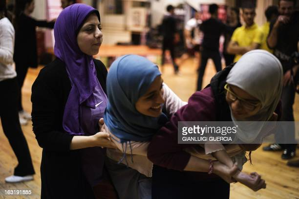 Egyptian and foreign women attend a self defense class at gym on February 21 2013 in Cairo Egypt Faced with a spike in sexual violence against female...