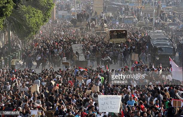 Egyptian antigovernment demonstrators face proregime opponents in Cairo's Tahrir Square where crowds have gathered for a protest calling for the...