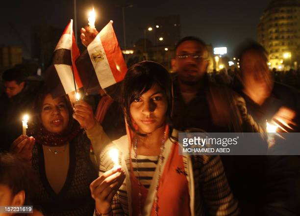 Egyptian antigovernment demonstrators hold a candlelight vigil at Cairo's Tahrir Square on February 9 2011 on the 16th day of consecutive protests...