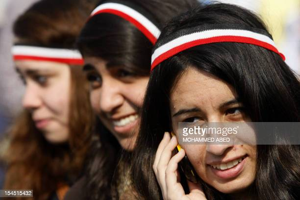 Egyptian antigovernment demonstrators wear headband with the colours of their national flag at Cairo's Tahrir square on February 9 2011 on the 16th...