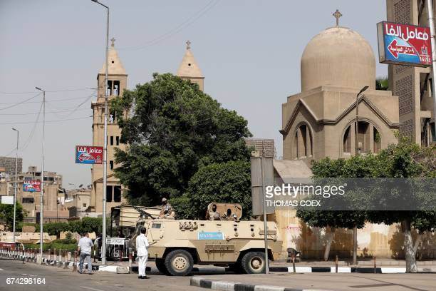 Egyptian army and police vehicles stand guard outside Saint Mark's Coptic Orthodox Cathedral in central Cairo a few hours before Pope Francis' visit...