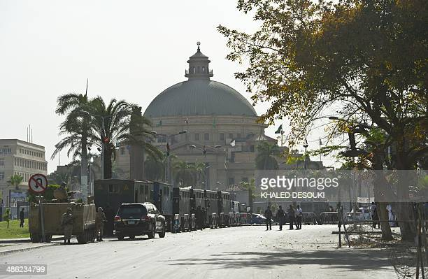 Egyptian army and riot police stand guard outside Cairo University in the capital Cairo on April 23 2014 Student backers of Egypt's ousted Islamist...