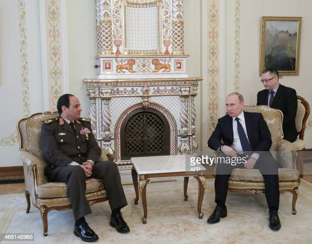 Egyptian army chief Abdel Fattah alSisi speaks with Russian President Vladimir Putin during their meeting in NovoOgaryovo residence outside Moscow on...