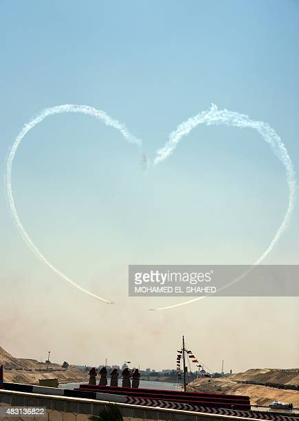 Egyptian army planes perform during a ceremony on August 6 2015 to unveil a 'new' Suez Canal in the port city of Ismailiya AFP PHOTO/ MOHAMED ELSHAHED