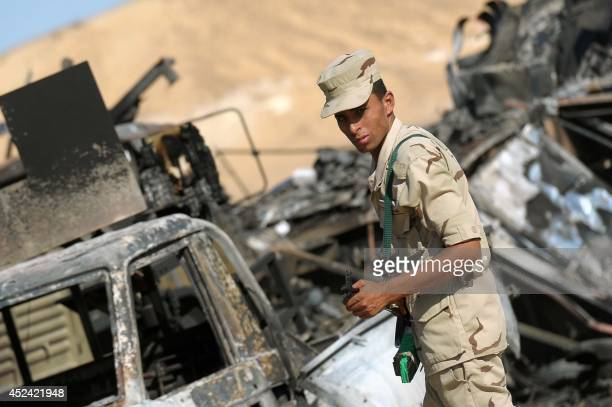 Egyptian army soldiers stand guard at the site of an attack in which 21 border guards where killed in alWadi alGadid close to the ElFarafrah oasis in...
