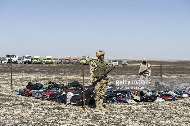 Egyptian army soldiers stand guard next to the luggage and belongings of passengers of the A321 Russian airliner piled up at the site of the crash in...