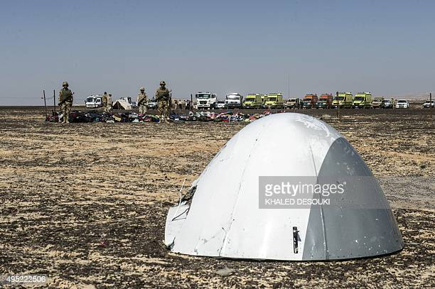 Egyptian army soldiers stand guard next to the plane nose of a crashed A321 Russian airliner at the site of the wreckage in Wadi alZolomat a...