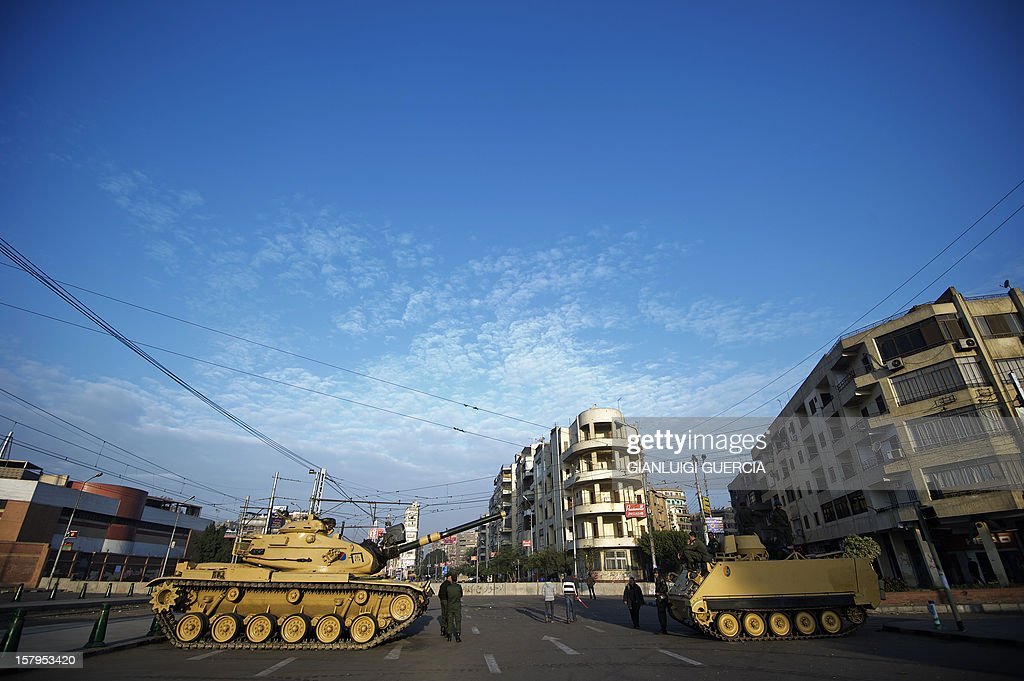 Egyptian army tanks deploy outside the presidential palace in Cairo on December 8, 2012, a day after a huge but peaceful protest overnight against President Mohamed Morsi, who has greatly expanded his powers and is pushing for disputed constitutional reform.
