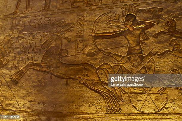 Egyptian art Great Temple of Ramses II 19th Dynasty Military campaign against the Hittites Ramses II in a chariot with a bow and arrow at the Battle...