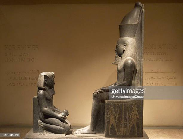 Egyptian Art Horemheb Last Pharaoh of 18th Dynasty New Kingdom Ruled from 1323 to 1295 BC Horemheb offerer kneeling before the god Atum Luxor Museum...