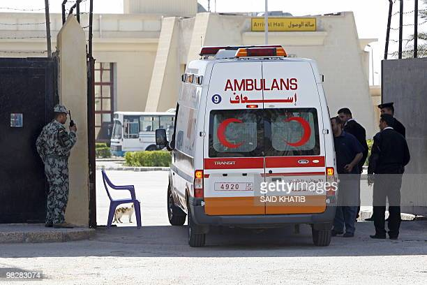 Egyptian border guards check the ambulance carrying conjoinedtwin Palestinian girls Retag and Retal at the Rafah border crossing in the southern Gaza...