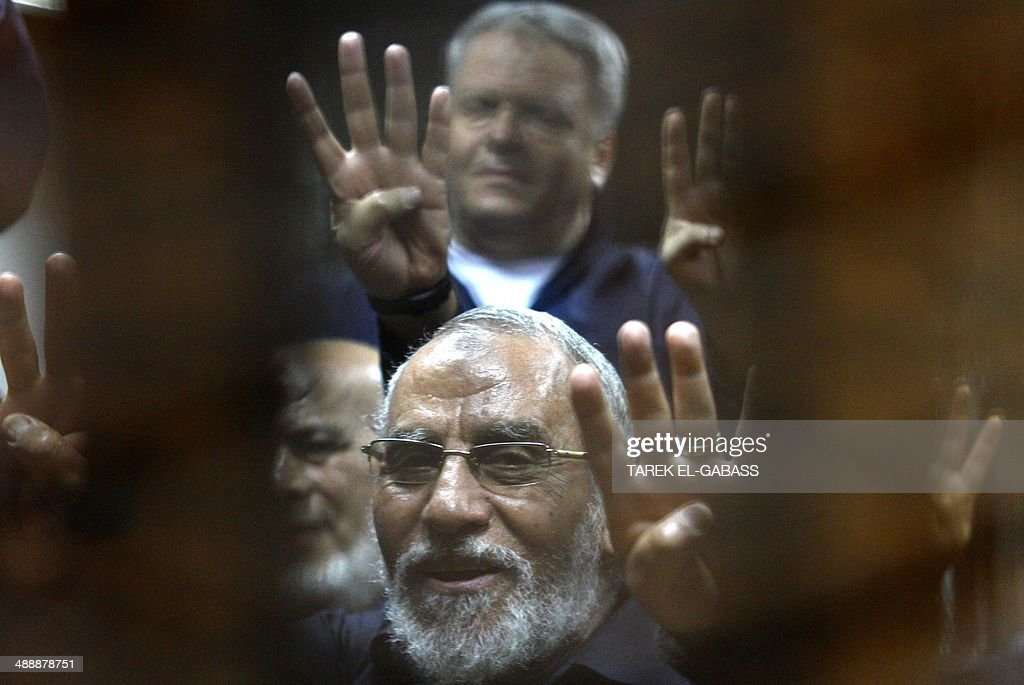 Egyptian Brotherhood's supreme guide Mohamed Badie flashes the 'Rabaa' sign which means four in Arabic remembering those killed in the crackdown on...