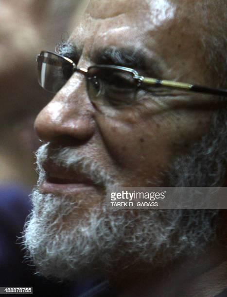 Egyptian Brotherhood's supreme guide Mohamed Badie sits inside a defendant cage during his trial at a police academy in Cairo on May 8 2014 Ousted...