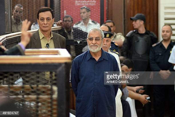 Egyptian Brotherhood's supreme guide Mohamed Badie stands in front of his judges during his trial in the capital Cairo on May 18 2014 An Egyptian...