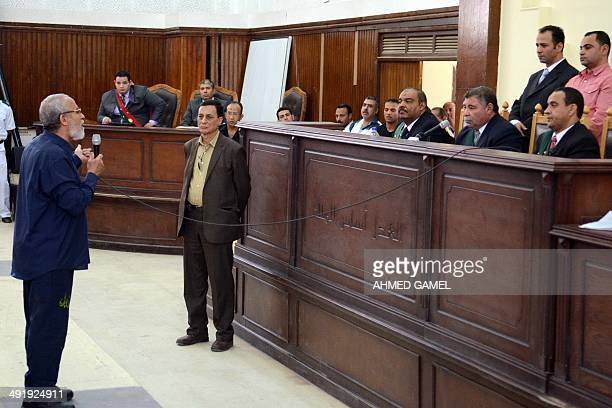 Egyptian Brotherhood's supreme guide Mohamed Badie talks to his judges during his trial in the capital Cairo on May 18 2014 An Egyptian court today...