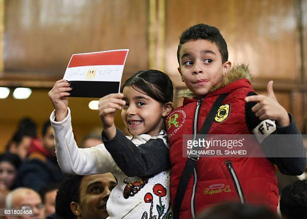 Egyptian children celebrate with a national flag defaced with the words 'Tiran' and 'Sanafir' after the High Administrative Court upheld on January...