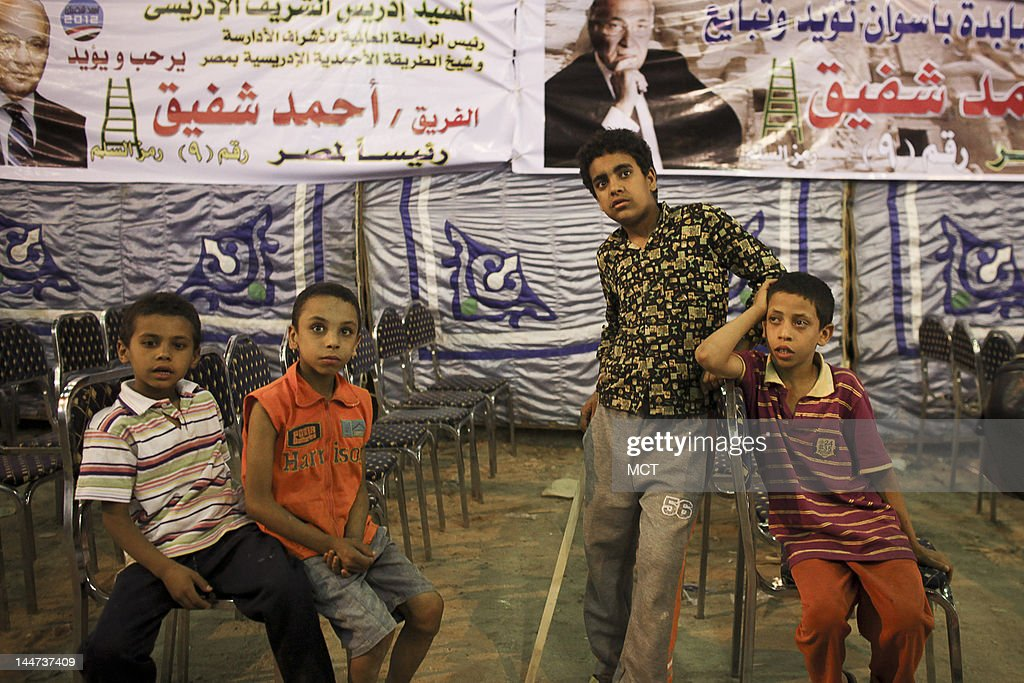 Egyptian children wait for presidential candidate Ahmed Shafik before a campaign rally in the Upper Egypt city of Aswan, Thursday, May 17, 2012. Shafik is one of 13 candidates running in the first presidential race since Hosni Mubarak was ousted in February 2011. The first round of the elections will take place next week on May 23 and 24.