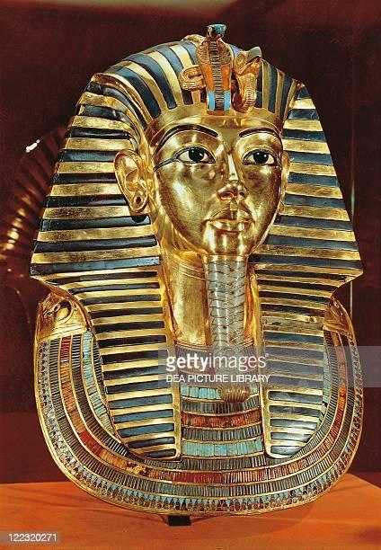 Egyptian civilization Burial mask of gold lapislazuli obsidian and turquoises of pharaoh Nebkheperura Tutankhamen Dynasty XVIII New Kingdom