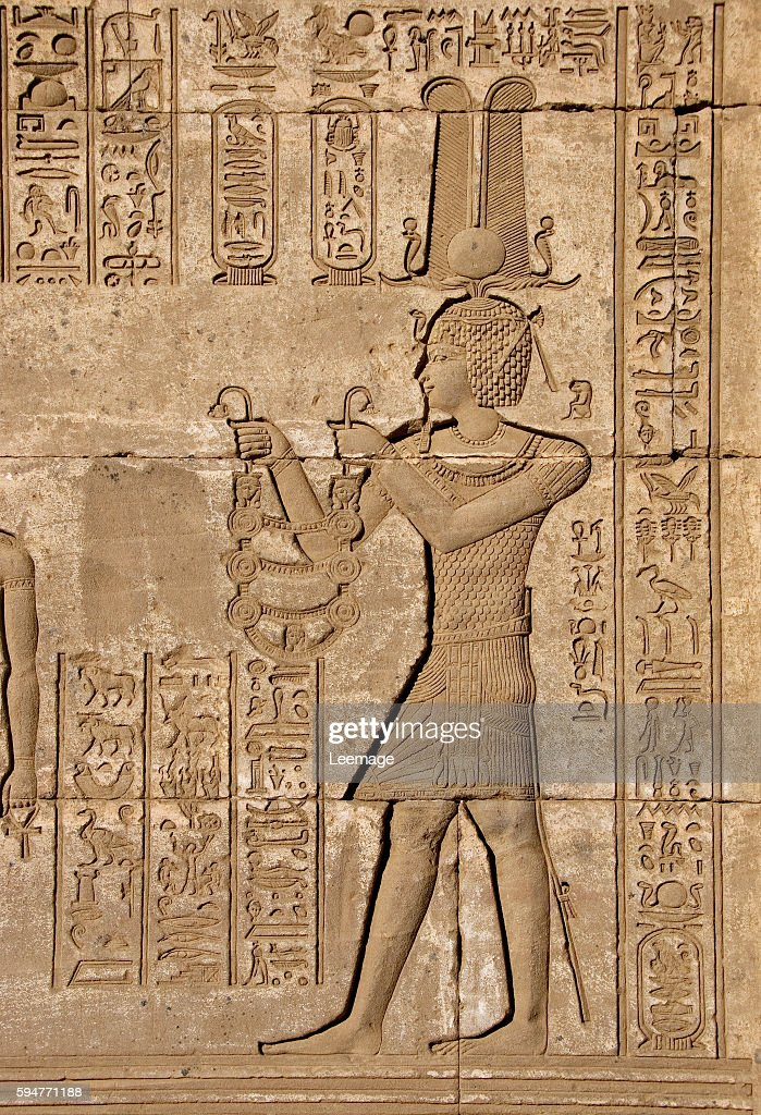 Emperor Trajan carrying offerings to the goddess Hathor detail of a Roman mammisi commemorating the birth of Ihy son of Isis carved on the wall of...