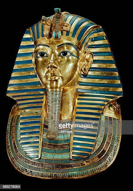 Golden funeral mask of the Pharaoh Tutankhamun From the Tomb of Tutankhamun in Dayr alBahri Valley of the Kings 18th dynasty h54 cm Egyptian National...