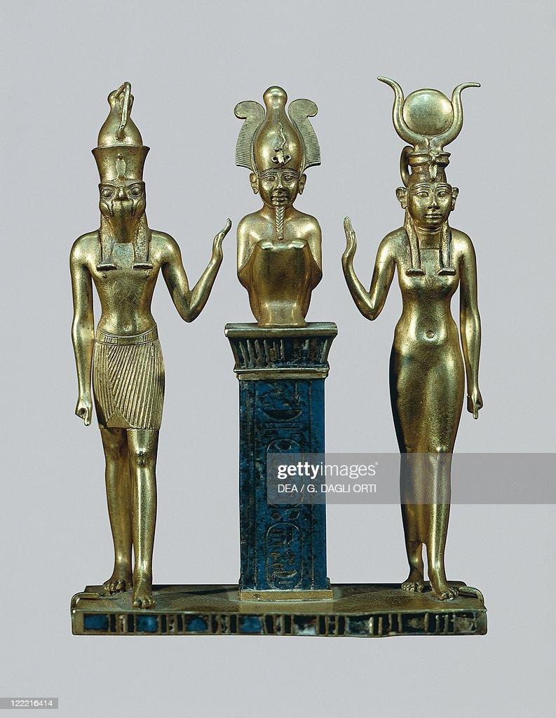 Egyptian civilization Middle Kingdom Dynasty XXII Gold and lapislazuli figurines of Osiris Horus and Isisthe triad of Osorkon 970730 bC
