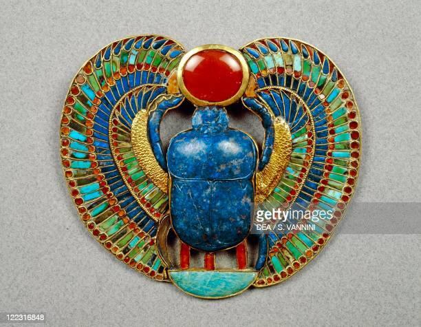 Egyptian civilization New Kingdom Dynasty XVIII Treasure of Tutankhamen Pectoral made of gold lapislazuli and semiprecious stones depicting a scarab...