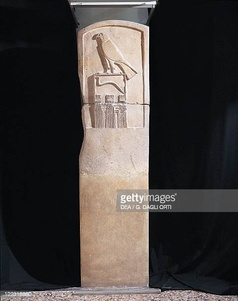 Egyptian civilization Old Kingdom Limestone stele of the Serpent King with basrelief depicting falcon god Horus and a cobra circa 3100 bC Height 143...