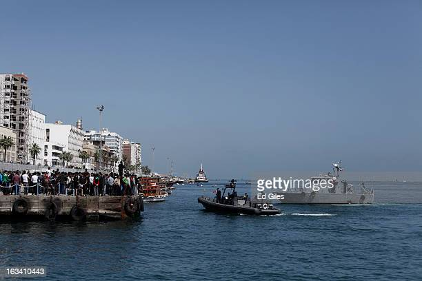 Egyptian coast guard vessels patrol the Suez Canal as residents of Port Said gather at a dock to demonstrate after the announcement of the final...