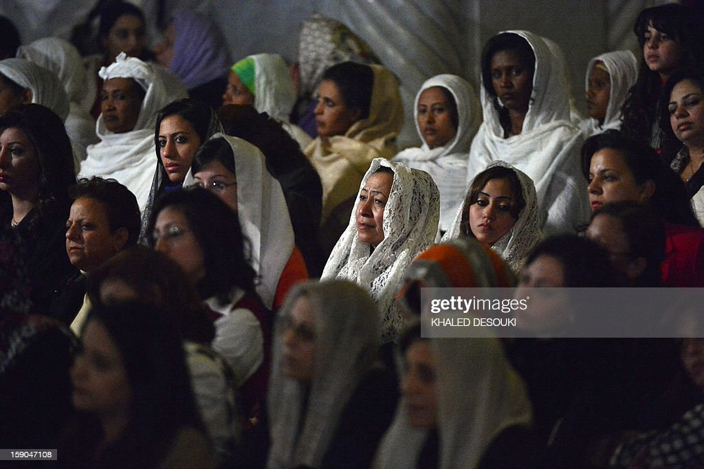 Egyptian Coptic Christian women attend Christmas midnight mass led by newly elected leader of Egypt's Coptic Christian, Pope Tawadros II, Head of the Egyptian Coptic Orthodox Church, at the al-Abasseya Cathedral in Cairo late on January 6, 2013. Copts of Egypt celebrate their first Christmas since the country has been ruled by Islamists in a climate of concern despite assurances from the authorities.