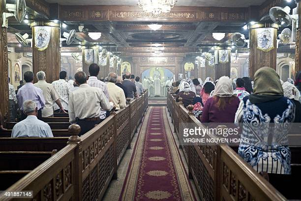 Egyptian Coptic Christians attend a Friday Mass at the Virgin Mary church on May 16 2014 in Cairo's Road alFarag district Hailed as a saviour for...