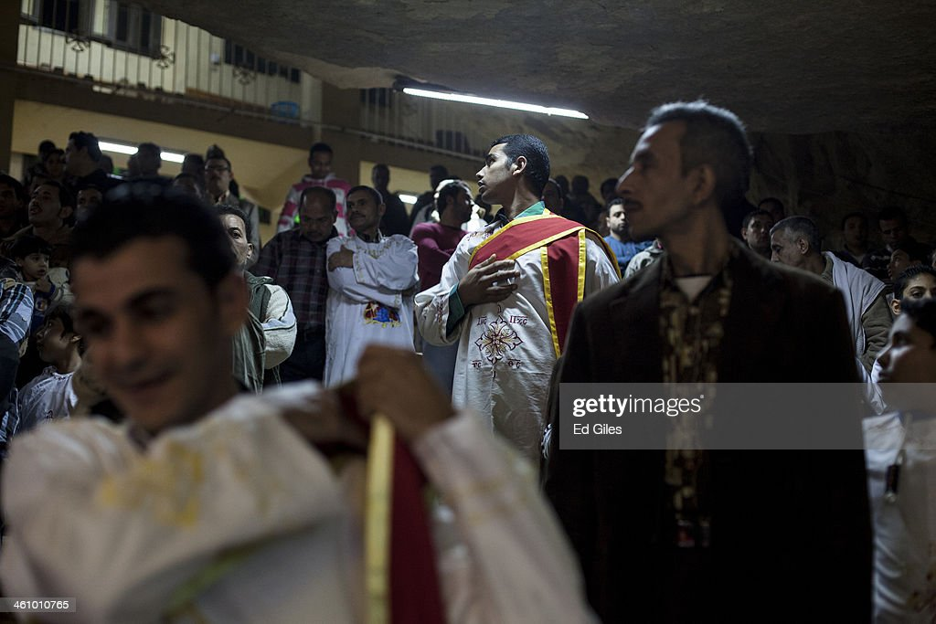 Egyptian coptic christians gather for a christmas eve mass in a chapel