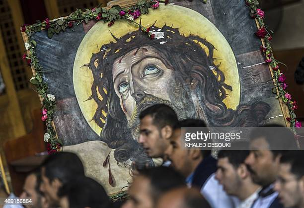 Egyptian Coptic Christians pray during the Orthodox Good Friday at the Samaan elKharaz monastery in Cairo's Mount Muqattam on April 10 2015 AFP PHOTO...