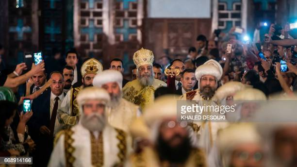 Egyptian Coptic Pope Tawadros II arrives to lead the Easter mass at the Saint Mark's Coptic Cathedral in Cairo's alAbbassiya district on April 15...