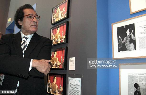 Egyptian Culture Minister Farouk Hosni looks at pictures as he inaugurates on June 16 2008 at the Paris Institut du Monde arabe the exhibition...