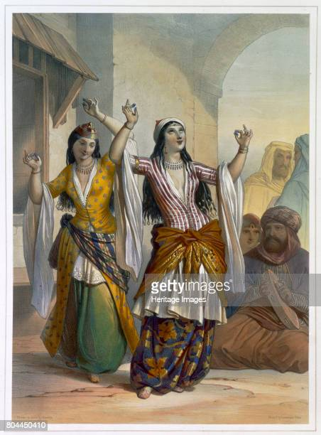 Egyptian dancing girls performing the Ghawazi at Rosetta Egypt 1848 Illustration from The Valley of the Nile by Emile Prisse d'Avennes Artist Achille...